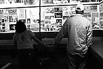 "A couple checks out the ""Wall of Fame"" featuring photographs, concert flyers and press clippings about bands that have played at Grant's Lounge over the years. Macon, Ga. Nov. 21, 2010."