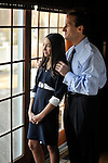 A Bat Mitzvah girl and her father share a quiet moment at home before her service and party