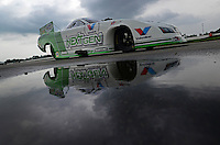 Sept. 1, 2012; Claremont, IN, USA: The car of NHRA funny car driver Jack Beckman reflects in a puddle as it is towed back to the pits during qualifying for the US Nationals at Lucas Oil Raceway. Mandatory Credit: Mark J. Rebilas-