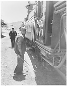 K-28 #475 with a southbound passenger train stopped at Embudo.  The engineer is oiling around, the fireman is tending the water tank and the conductor is looking on.<br /> D&amp;RGW  Embudo, NM  circa 1940