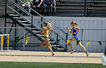 FARGO, ND - MAY 13: Taylor Janssen from North Dakota State University passes Emily Donnay from South Dakota State down the stretch in the women's 1,500 meter run Saturday at the 2017 Summit League Outdoor Track Championship at the Ellig Sports Complex in Fargo, ND. (Photo by Dave Eggen/Inertia)
