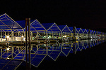 Boat slips of the Coeur D Alene Resort marina inside  the floating boardwalk on an October night.