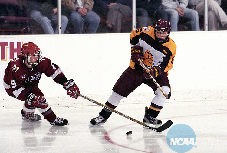 23 MAR 2003:  Krista McArthur (6) of Minnesota-Duluth defends against Nicole Corriero (9) of Harvard University during the Division 1 Women's Ice Hockey Championship held at the Duluth Entertainment and Convention Center on the University of Minnesota-Duluth campus in Duluth, MN.  Minnesota-Duluth won 4-3 for the championship title.  David Ballard/NCAA Photos