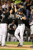 Chicago White Sox second baseman Gordon Beckham (15) after hitting a home run greeted by Mark Kotsay (7) during a game vs. the Detroit Tigers at U.S. Cellular Field in Chicago, Illinois August 13, 2010.   Chicago defeated Detroit 8-4.  Photo By Mike Janes/Four Seam Images