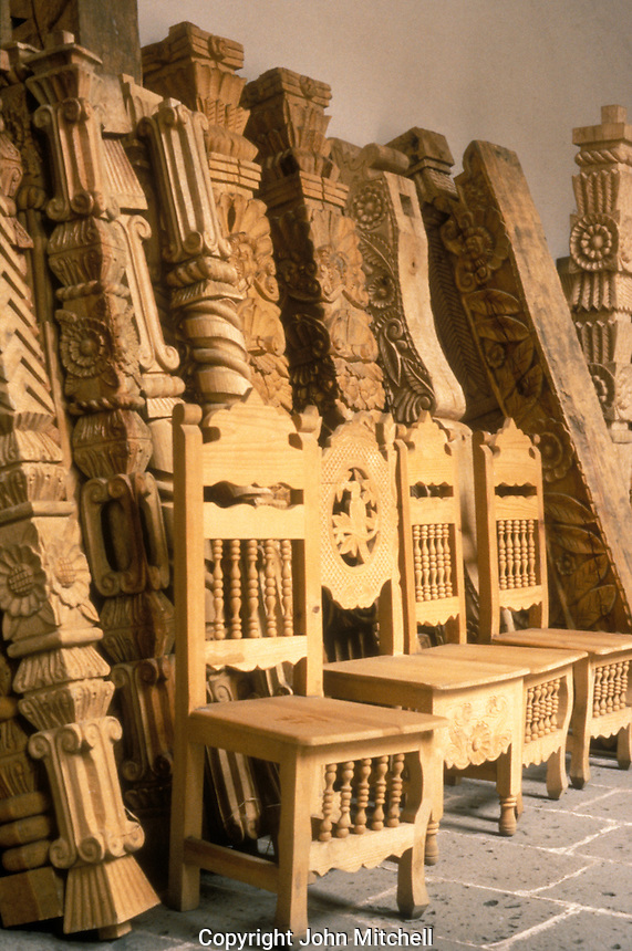 Handmade wooden furniture in the Casa de Artesanias, which is housed in the San Francisco Convent, Morelia, Michoacan. The Casa de Artesanias displays and sells handicrafts from all over the state of Michoacan.