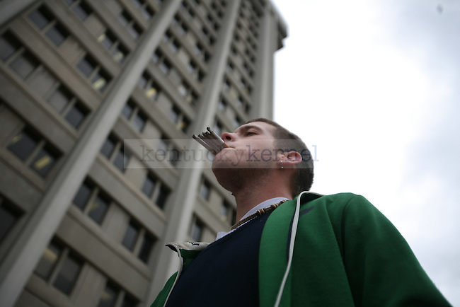 Entrepreneuership junior Carter Padgett smokes five cigarettes at a time for the protest against the newly implemented tobacco ban at Patterson Office Tower on Thursday, Nov. 19, 2009. Photo by Adam Wolffbrandt | Staff