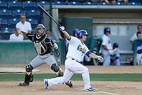 Scott Schebler #24 of the Rancho Cucamonga Quakes bats while Dane Phillips #24 of the Lake Elsinore Storm prepares to throw to second base during a game at LoanMart Field on August 6, 2013 in Rancho Cucamonga, California. Lake Elsinore defeated Rancho Cucamonga, 13-5. (Larry Goren/Four Seam Images)
