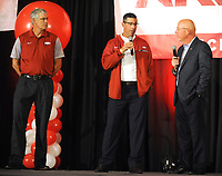 NWA Democrat-Gazette/ANDY SHUPE<br /> Dan Enos (center), offensive coordinator Dan Enos (left) speaks Friday, Aug. 18, 2017, with Chuck Barrett, voice of the Razorbacks, as Paul Rhoads, defensive coordinator, l listens, during the Kickoff Luncheon at the Northwest Arkansas Convention Center in Springdale. Visit nwadg.com/photos to see more photographs from the luncheon.