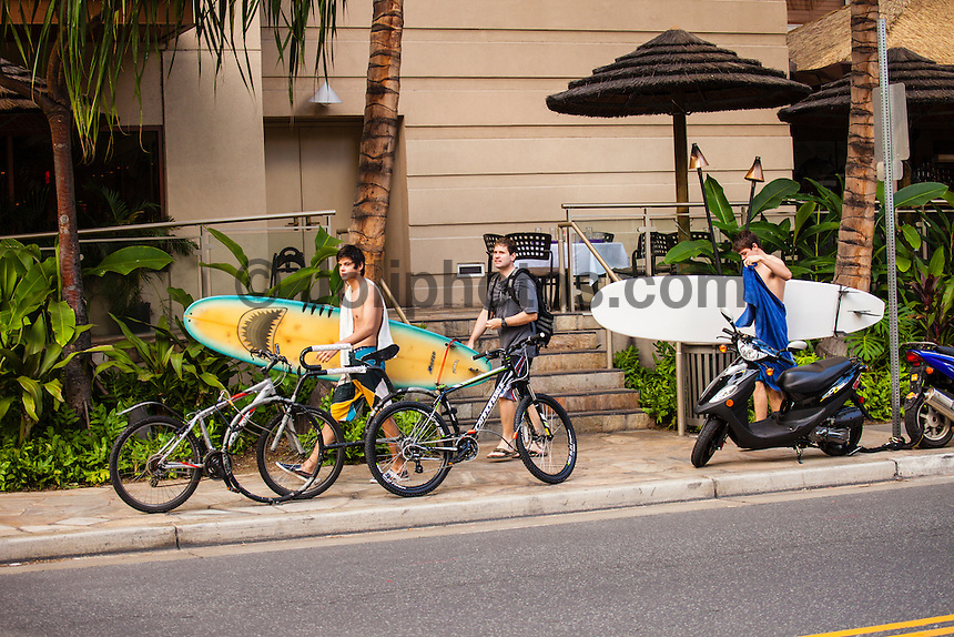 HONOLULU, Waikiki, Oahu. - (Friday, December 21, 2012) Surfers in the streets of Waikiki.--The tourist spot of Waikiki was busy today with Christmas holiday crowds. Photo: joliphotos.com