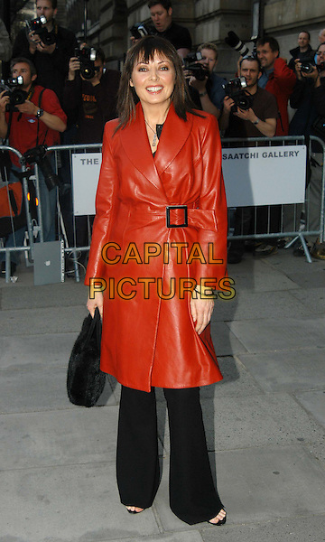 CAROL VORDERMAN.Launch of the Saatchi Gallery's new home at County Hall.www.capitalpictures.com.sales@capitalpictures.com.©Capital Pictures.red leather wrap coat