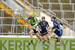 Kerry's Tom Murnane sprints past Matt Lynch and Barry O'Grady left in the Waterford Crystal Hurling cup in Fitzgerald Stadium on Sunday