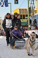 Musher Hans Gatt and Iditarider  Carol Rickman.leave the 2011 Iditarod ceremonial start line in downtown Anchorage, Alaska