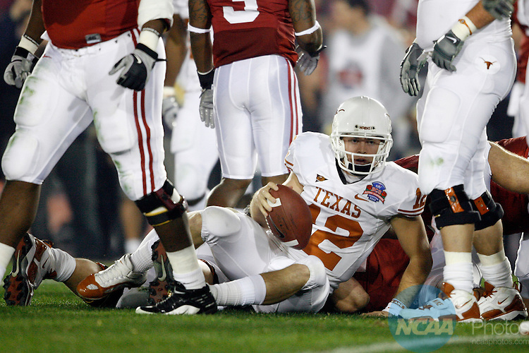 07 JAN 2010:  Colt McCoy (12) of the University of Texas plays his last play of the game against the University of Alabama during the BCS National Championship held at the Rose Bowl in Pasadena, CA.  Alabama defeated Texas 37-21 for the national title. Jamie Schwaberow/NCAA Photos