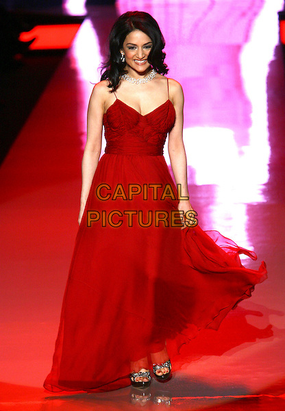 ARCHIE PANJABI .The Heart Truth Fall 2011 fashion show during Mercedes-Benz Fashion Week at The Theatre at Lincoln Center on New York City, New York, NY, USA,.9th February 2011..catwalk runway model modeling full length red dress long maxi walking .CAP/ADM/PZ.©Paul Zimmerman/AdMedia/Capital Pictures.