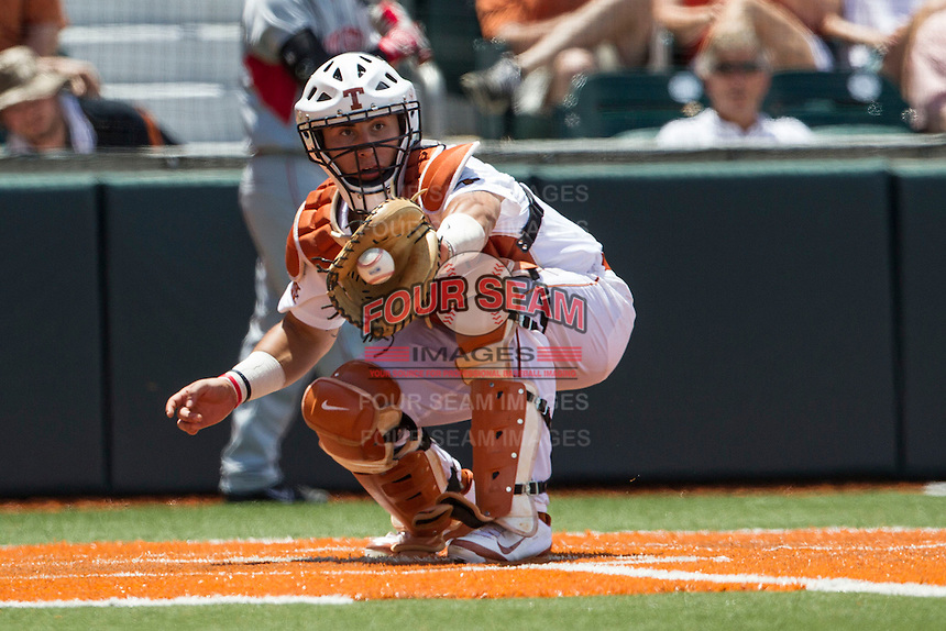 Texas Longhorns catcher Tres Barrera (1) makes a catch and force out at home during the NCAA Super Regional baseball game against the Houston Cougars on June 7, 2014 at UFCU Disch–Falk Field in Austin, Texas. The Longhorns are headed to the College World Series after they defeated the Cougars 4-0 in Game 2 of the NCAA Super Regional. (Andrew Woolley/Four Seam Images)
