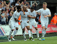 Andre Ayew of Swansea City (2nd L) celebrates his equaliser with team mates ( L-R ) Leroy Fer and Jefferson Montero and Stephen Kingsley during the Swansea City FC v Manchester City Premier League game at the Liberty Stadium, Swansea, Wales, UK, Sunday 15 May 2016