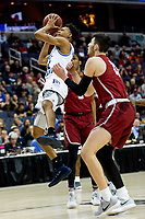 Washington, DC - MAR 10, 2018: Rhode Island Rams guard Jeff Dowtin (11) hits an acrobatic shoot during the semi final match up of the Atlantic 10 men's basketball championship between Saint Joseph's and Rhode Island at the Capital One Arena in Washington, DC. (Photo by Phil Peters/Media Images International)