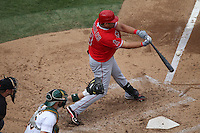 OAKLAND, CA - SEPTEMBER 5:  Kendrys Morales #8 of the Los Angeles Angels bats against the Oakland Athletics during the game at O.co Coliseum on Wednesday, September 5, 2012 in Oakland, California. Photo by Brad Mangin
