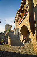 Spello, Umbria, Italy, June 2006. The walled city of Spello is perched high on a hill and shaped by many narrow alleys and cobble stone streets. From its walls one has a beautiful view over the surrounding countryside with its medieval walled villages and cities, olive groves and vineyards. Photo By Frits Meyst/Adventure4ever.com