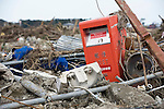 A postbox remains standing among the rubble in Higashimatsushima, Miyagi Prefecture, Japan on  23 March 20011. Some 500 mail boxes were washed away in Japan's northeast following the March 11 quake and tsunamis. Photographer: Robert Gilhooly