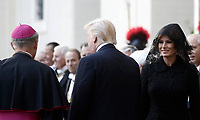 US President Donald Trump and his wife Melania are welcomed by Archibishop Mons. Georg Gaenswein, as they arrive at the San Damaso courtyard for a private audience with Pope Francis, at the Vatican, May 24, 2017.<br /> UPDATE IMAGES PRESS/Isabella Bonotto<br /> STRICTLY ONLY FOR EDITORIAL USE