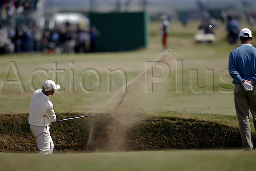16 July 2004: Japanese golfer SHIGEKI MARUYAMA  (JPN) plays from a bunker during the second round of The Open Championship played at Royal Troon, Scotland. Photo: Glyn Kirk/Action Plus...golf golfer golfing 040716