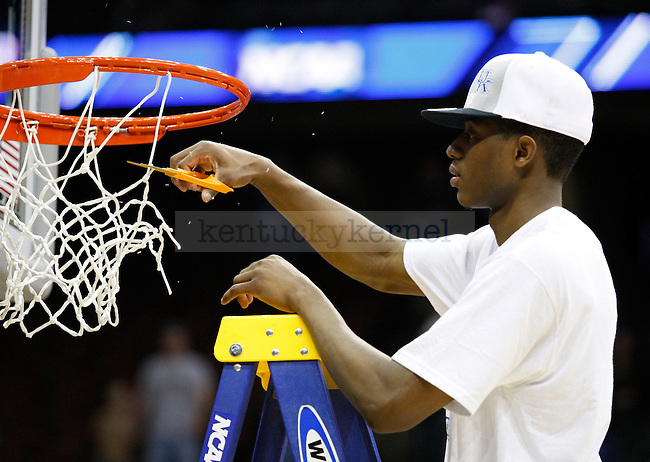 Brandon Knight cut down part of the net after winning in the Elite 8 game of the 2011 NCAA Basketball Tournament, at the Prudential Center, in Newark, NJ.  Photo by Latara Appleby | Staff