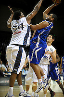 Saints guard Corey Webster lays up under pressure from Darryl Dora. NBL - Wellington Saints v Nelson Giants at TSB Bank Arena, Wellington, New Zealand on Thursday, 19 May 2011. Photo: Dave Lintott / lintottphoto.co.nz