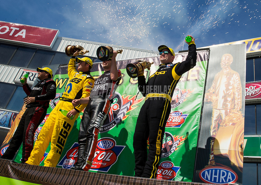 Jun. 1, 2014; Englishtown, NJ, USA; (from right to left) NHRA top fuel driver Richie Crampton , pro stock motorcycle rider Andrew Hines , pro stock driver Jeg Coughlin jr and funny car driver Cruz Pedregon celebrate on the podium after winning the Summernationals at Raceway Park. Mandatory Credit: Mark J. Rebilas-