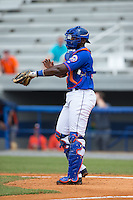 Kingsport Mets catcher Darryl Knight (22) gives defensive signs during the game against the Greeneville Astros at Hunter Wright Stadium on July 7, 2015 in Kingsport, Tennessee.  The Mets defeated the Astros 6-4. (Brian Westerholt/Four Seam Images)