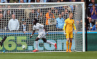 SWANSEA, WALES - MAY 17: Bafetimbi Gomis (L) of Swansea celebrates his goal next to a dejected goalkeeper Joe Hart of Manchester City, which made the score 2-2 during the Premier League match between Swansea City and Manchester City at The Liberty Stadium on May 17, 2015 in Swansea, Wales. (photo by Athena Pictures/Getty Images)