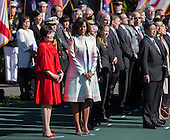 First lady Michelle Obama and Mrs. Abe participate in a welcoming ceremony at The White House in Washington DC during a State Visit, April 28, 2015. <br /> Credit: Chris Kleponis / CNP