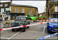 BNPS.co.uk (01202 558833)<br /> Pic: GrahamHunt/BNPS<br /> <br /> Epic Fail...A Landrover to be used in the getaway is still at the scene.<br /> <br /> Inept ram raiders have demolished half the wall of a furniture showroom in the sleepy Dorset town of Beaminster last night.<br /> <br /> The cash machine is still to believed to be in the rubble and the robbers were forced to abandon the tractor used in the raid.