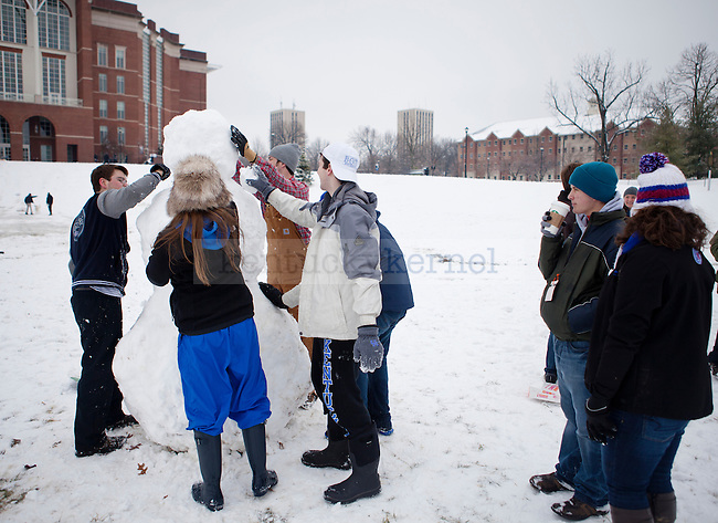 "Students build a ""basketball player size"" snowman in front of  William T. Young Library in Lexington, Ky., on Monday, February 3, 2014. Photo by Emily Wuetcher  