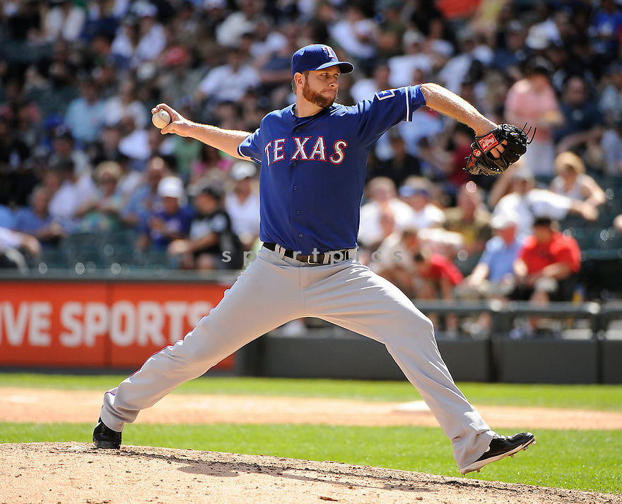 SCOTT FELDMAN, of the Texas Rangers in action during the Rangers game against the Chicago White Sox on August 21, 2011 at Cellular Field in Chicago, IL. The White Sox beat the Rangers 10-0.