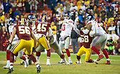 New York Giants quarterback Eli Manning (10) looks for a receiver late in the fourth quarter against the Washington Redskins at FedEx Field in Landover, Maryland on Thursday, November 23, 2017.  Manning threw an interception on the play, ending the Giants' chance for a come-back. The Redskins won the game 20 - 10.<br /> Credit: Ron Sachs / CNP<br /> (RESTRICTION: NO New York or New Jersey Newspapers or newspapers within a 75 mile radius of New York City)