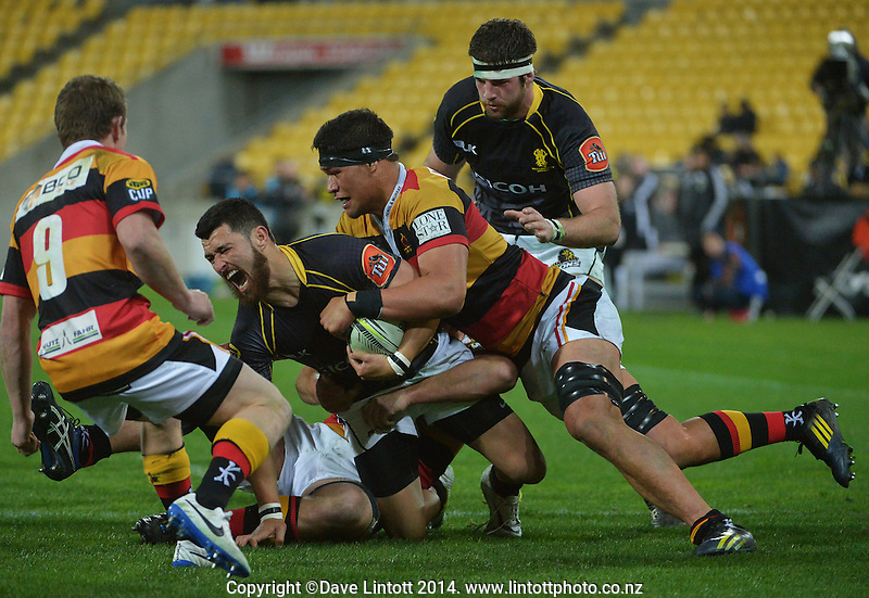 Jared Kahu is tackled during the ITM Cup rugby union match between Wellington Lions and Waikato at Westpac Stadium, Wellington, New Zealand on Saturday, 16 August 2014. Photo: Dave Lintott / lintottphoto.co.nz