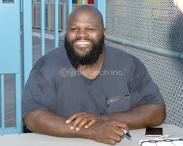 Brooklyn, NY - AUGUST 17: WWE Superstar MArk Henry visits MCU Park in Brooklyn, New York on August 17, 2017 during Summer Slam Week. Photo Credit: George Napolitano/MediaPunch