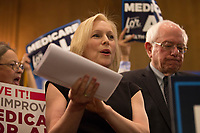 "United States Senator Kirsten Gillibrand (Democrat of New York), left, joins US Senator Bernie Sanders (Independent of Vermont), right, as he announces he has introduced a new version of his ""Medicare for All"" plan at a press conference on Capitol Hill in Washington DC on April 10, 2019.  The Sanders plan will replace job-based and private health insurance with a government plan that guarantees coverage, including long-term care, for all citizens. Photo Credit: Stefani Reynolds/CNP/AdMedia"