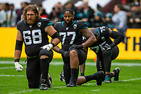 3rd November 2019; Wembley Stadium, London, England; National Football League, Houston Texans versus Jacksonville Jaguars; Offensive Linemen Andrew Norwell, Cedric Ogbuehi and Jawaan Taylor of Jacksonville Jaguars warm up - Editorial Use