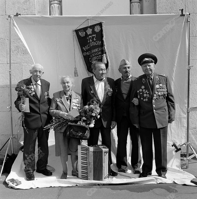 WWII veterans during Victory Day celebrations, left to right: Yevgeny Petrovich Ostroumov, b. 1924, Officer, Infantry; Valentina Yakovlevna Baikova, b. 1923, Nurse; Valery Pavlovich Ilyakov, b. 1925, Officer, Reconnaissance; Iosif Izraelevich Abugov, b. 1926, Private, Infantry; Mikhail Fomich Klimov, b. 1919, Officer, Reconnaissance. Moscow, Russia, May 9, 2008