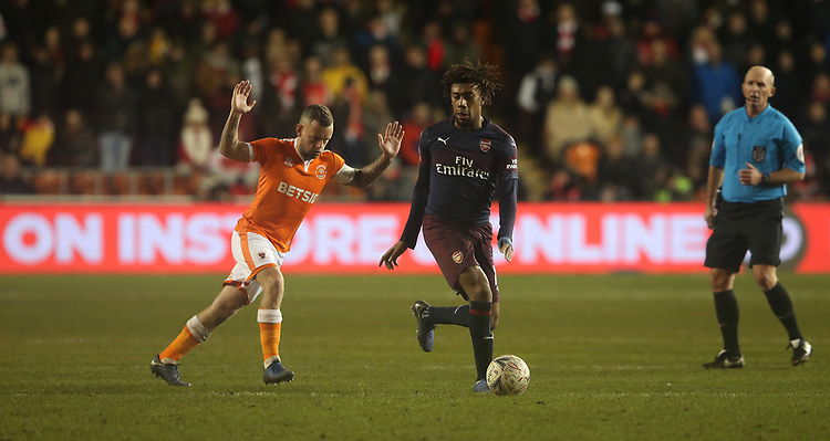 Arsenal's Alex Iwobi shields the ball from Blackpool's Jay Spearing<br /> <br /> Photographer Stephen White/CameraSport<br /> <br /> Emirates FA Cup Third Round - Blackpool v Arsenal - Saturday 5th January 2019 - Bloomfield Road - Blackpool<br />  <br /> World Copyright &copy; 2019 CameraSport. All rights reserved. 43 Linden Ave. Countesthorpe. Leicester. England. LE8 5PG - Tel: +44 (0) 116 277 4147 - admin@camerasport.com - www.camerasport.com