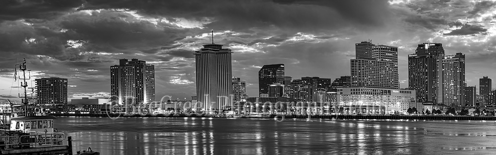 We capture this black and white panorama of the New Orleans skyline in downtown area around dusk as the high rise building light came on and it created this nice reflections in the Mississippi River.