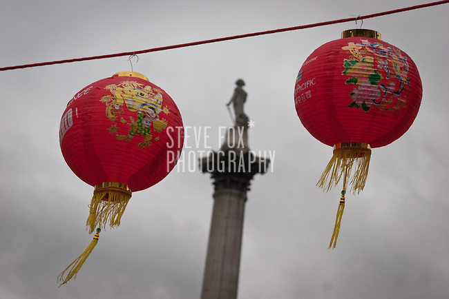 Nelsons Column framed between two lanterns, Chinese New Year 2011, Trafalgar Square, London, England