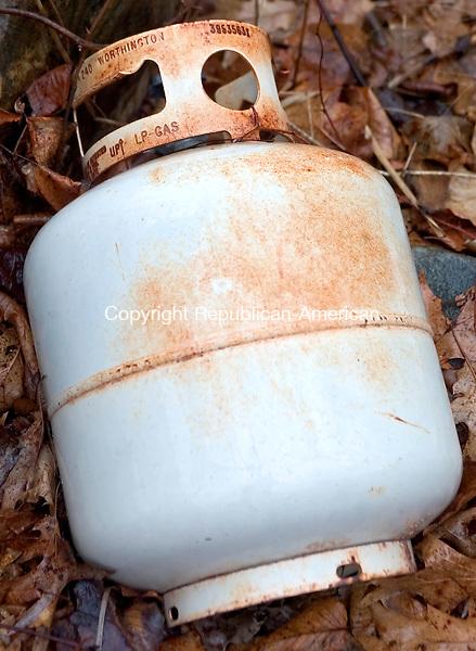 WATERBURY, CT. 12 April 2007-041207SV07--A old propane tank found on Platts Mills Road in Waterbury.<br /> Steven Valenti Republican-American
