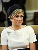Queen Maxima of the Netherlands listens to United States President Barack Obama (unseen) and King Willem-Alexander of the Netherlands (unseen) during a meeting in the Oval Office of the White House on June 1, 2015, in Washington, DC. <br /> Credit: Aude Guerrucci / Pool via CNP