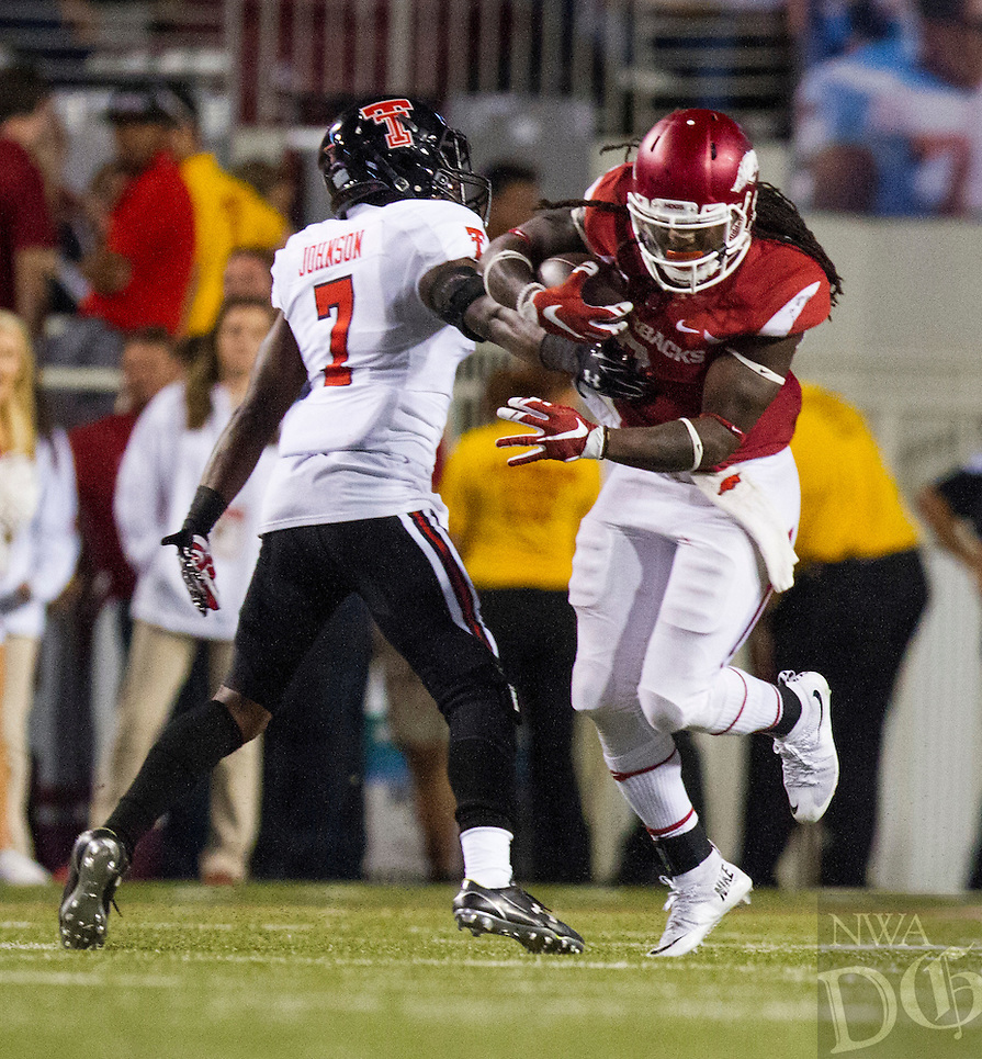 Arkansas Democrat-Gazette/MELISSA SUE GERRITS - 09/19/15 - Arkansas Razorbacks' Alex Collins attempts to tear free of Texas Tech's Davis Webb September 19, 2015 at Donald W. Reynolds Razorbacks Stadium in Fayetteville in the middle of the 4th quarter.