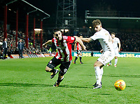 Neal Maupay of Brentford takes on Gaetano Berardi of Leeds United during the Sky Bet Championship match between Brentford and Leeds United at Griffin Park, London, England on 4 November 2017. Photo by Carlton Myrie.