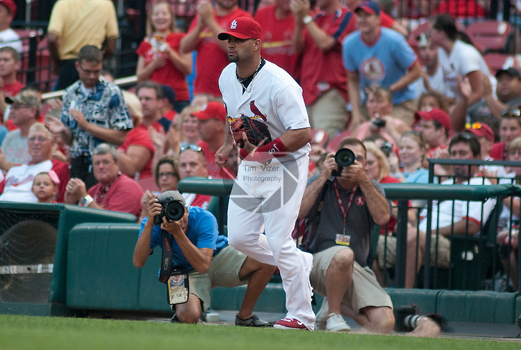 06 July 2011              St. Louis Cardinals first baseman Albert Pujols (5) runs onto the field at the start of the game as he returns to baseball after about a month off due to a broken wrist. The Cincinnati Reds defeated the St. Louis Cardinals 9-8 in 13 innings in the final game of a three-game series on Wednesday July 6, 2011 at Busch Stadium in downtown St. Louis.