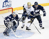 Matt DiGirolamo (UNH - 30), Anders Lee (Notre Dame - 9), Mike Beck (UNH - 25) - The University of Notre Dame Fighting Irish defeated the University of New Hampshire Wildcats 2-1 in the NCAA Northeast Regional Final on Sunday, March 27, 2011, at Verizon Wireless Arena in Manchester, New Hampshire.